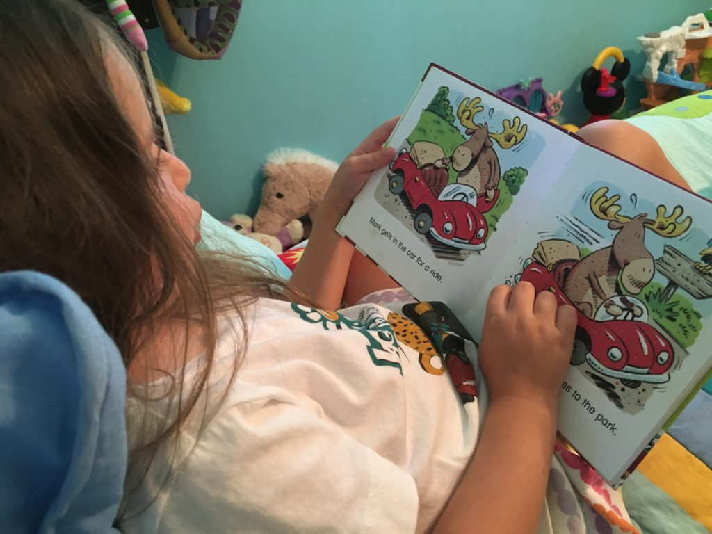 preschooler reading on her own