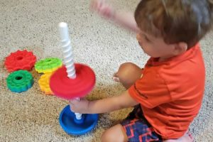 3 year old playing with Fat Brain Toys SpinAgain toy   sahmplus.com