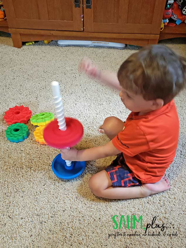 3 year old playing with Fat Brain Toys SpinAgain toy | sahmplus.com