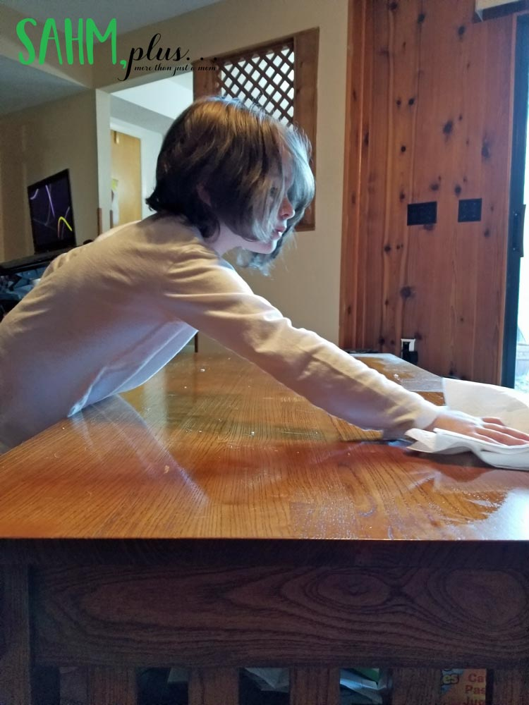 my 6 year old cleaning and dusting the coffee table as a consequence chore
