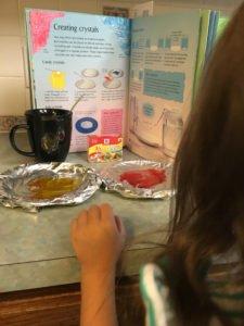 girl science nerd making sugar crystals