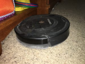 Here, the Roomba got stuck under a shelf in the playroom
