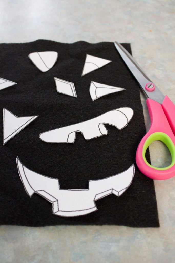 cut face pieces felt pumpkin activity