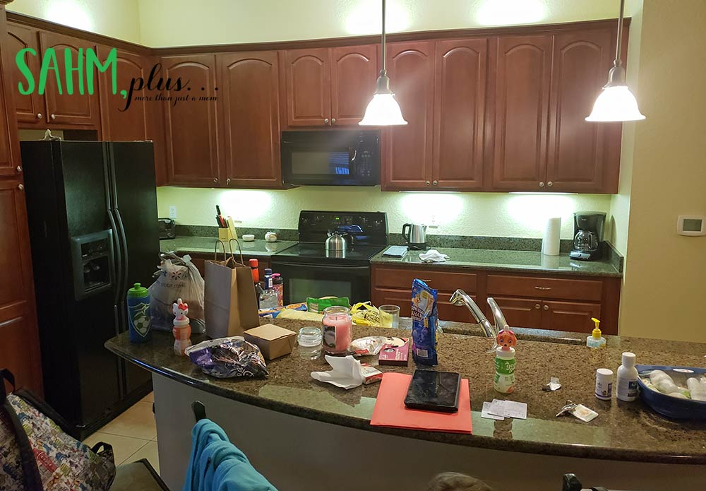 Large (and cluttered) kitchen with a crowing staying at an Airbnb rental | sahmplus.com