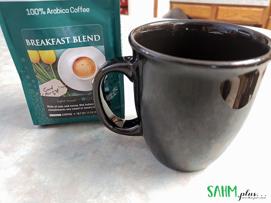 photo of bag of coffee and black coffee mug | sahmplus.com