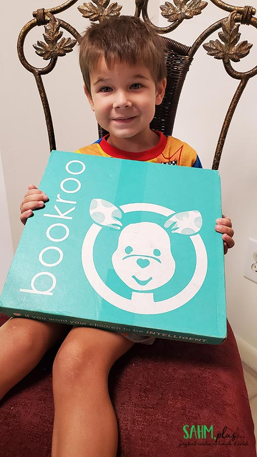 4 year old with Bookroo Box ready to Keep Calm and Read On!
