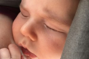 Breastfeed in a carrier: my son asleep in the carrier after being breastfed | www.sahmplus.com