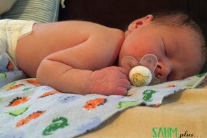 baby asleep on a blanket on tummy | sahmplus.com