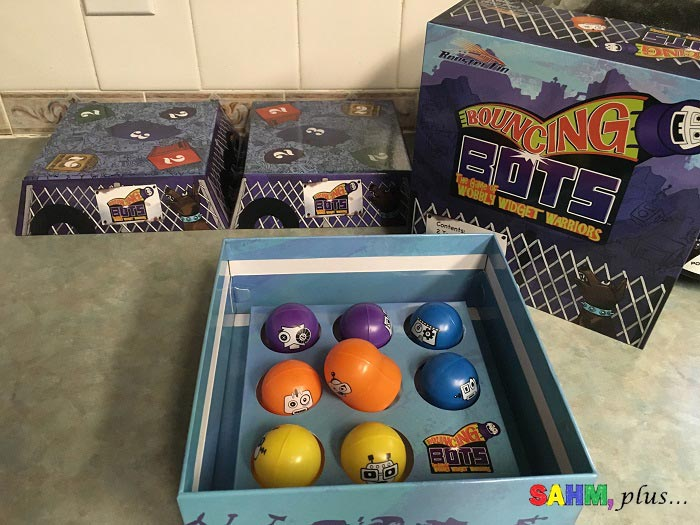 Bouncing Bots game by Rooster Fin; Pieces include instructions, 2 targets, 8 bouncing bots - providing family motor skills challenge | www.sahmplus.com