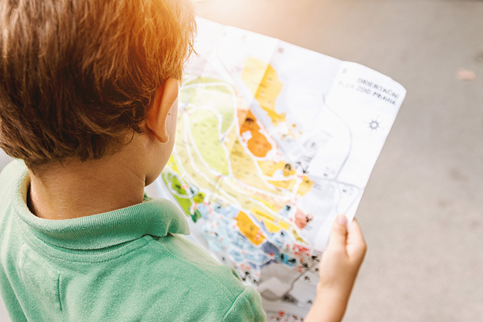 young boy with map