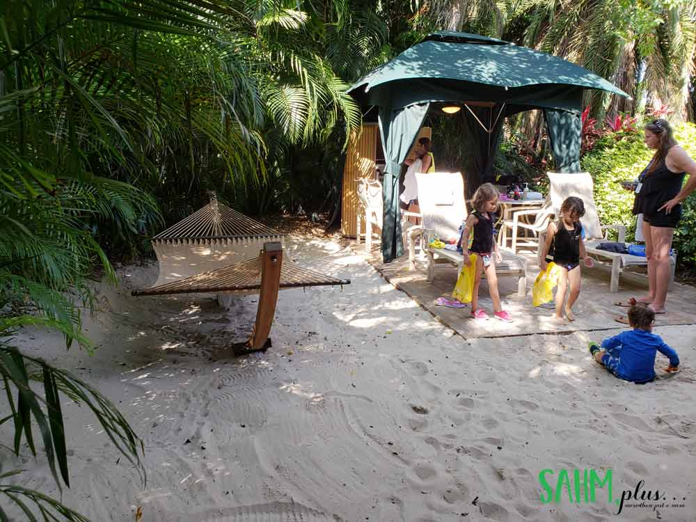 4 adults and 3 young kids at Discovery Cove in our private cabana | sahmplus.com
