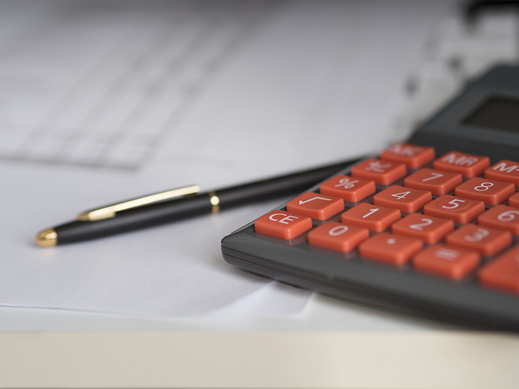 Calculator and getting documents ready for travel- secure travel insurance