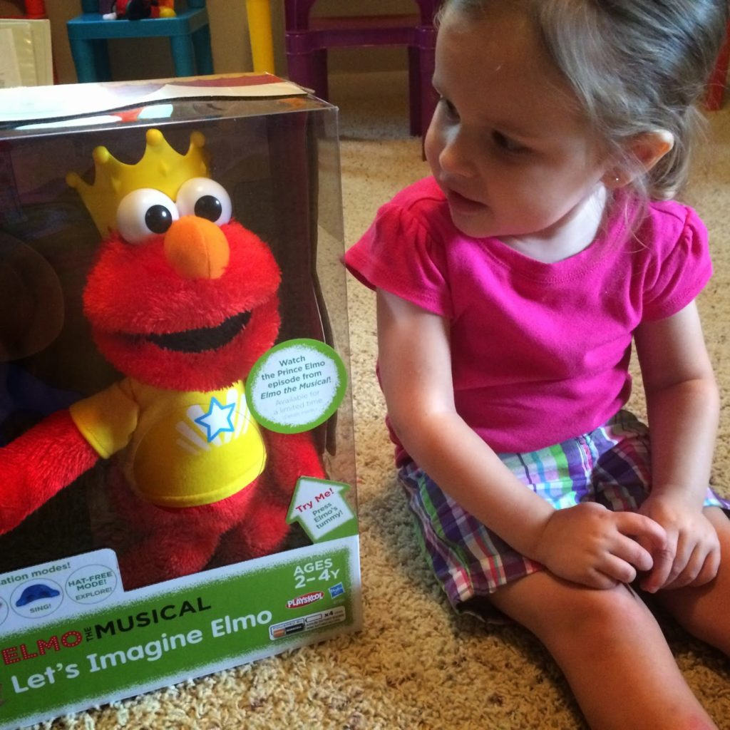 Let's Imagine Elmo review | child staring at Elmo in box | www.sahmplus.com
