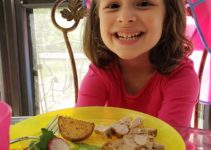 Child smiling about her meal made from PlateJoy menu plan | sahmplus.com