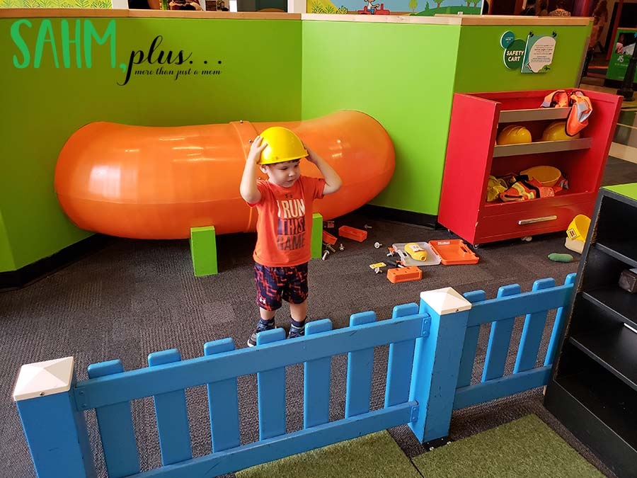 Toddler boy imaginary play in hard hat at Glazer Children's Museum | sahmplus.com