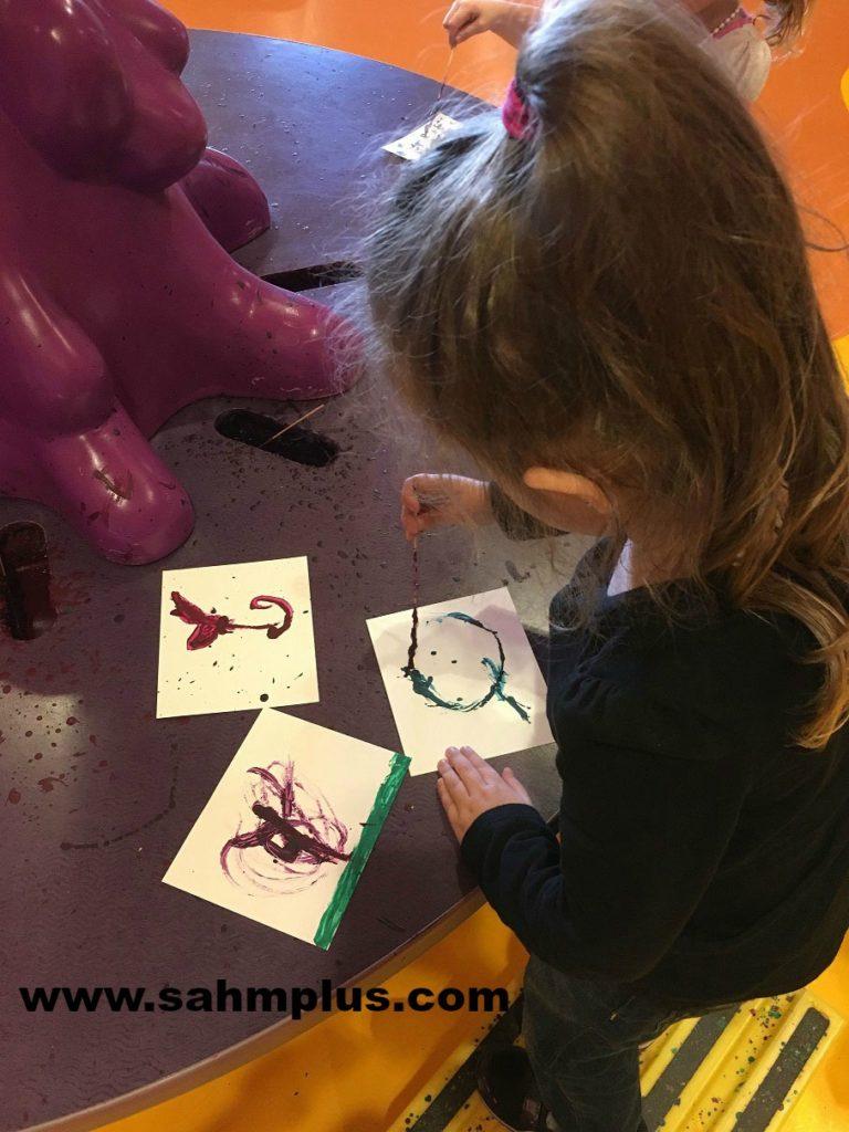 Rock motherhood: Encourage child's interests - S painting at Crayola. #RockingMotherhood