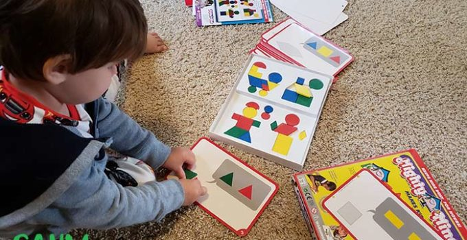 child playing tangram puzzle Might Mind