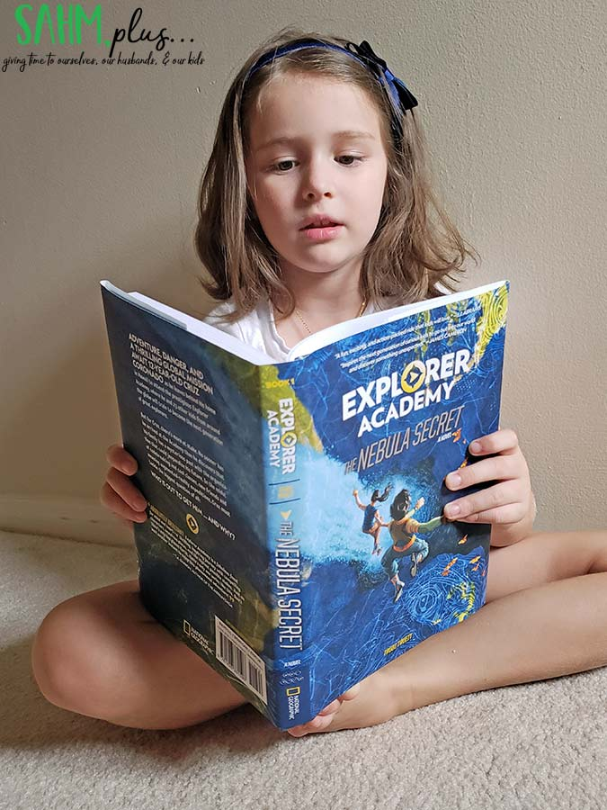 child reading The Nebula Secret from National Geographic Kids | sahmplus.com