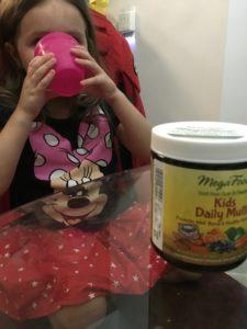 child vitamins child drinking MegaFood vitamins