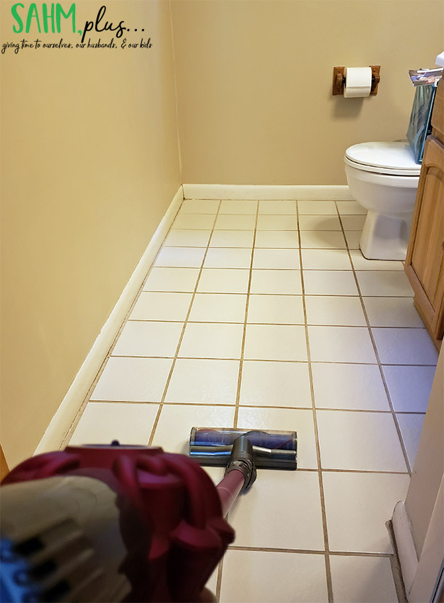 cleaning bathroom tile with dyson stick vac | sahmplus.com