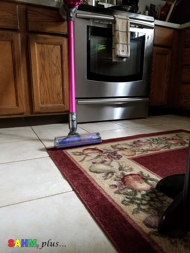 Vacuum set in a clean kitchen. Image for best housekeeping schedule for a SAHM and free printable cleaning schedule for stay at home moms | www.sahmplus.com
