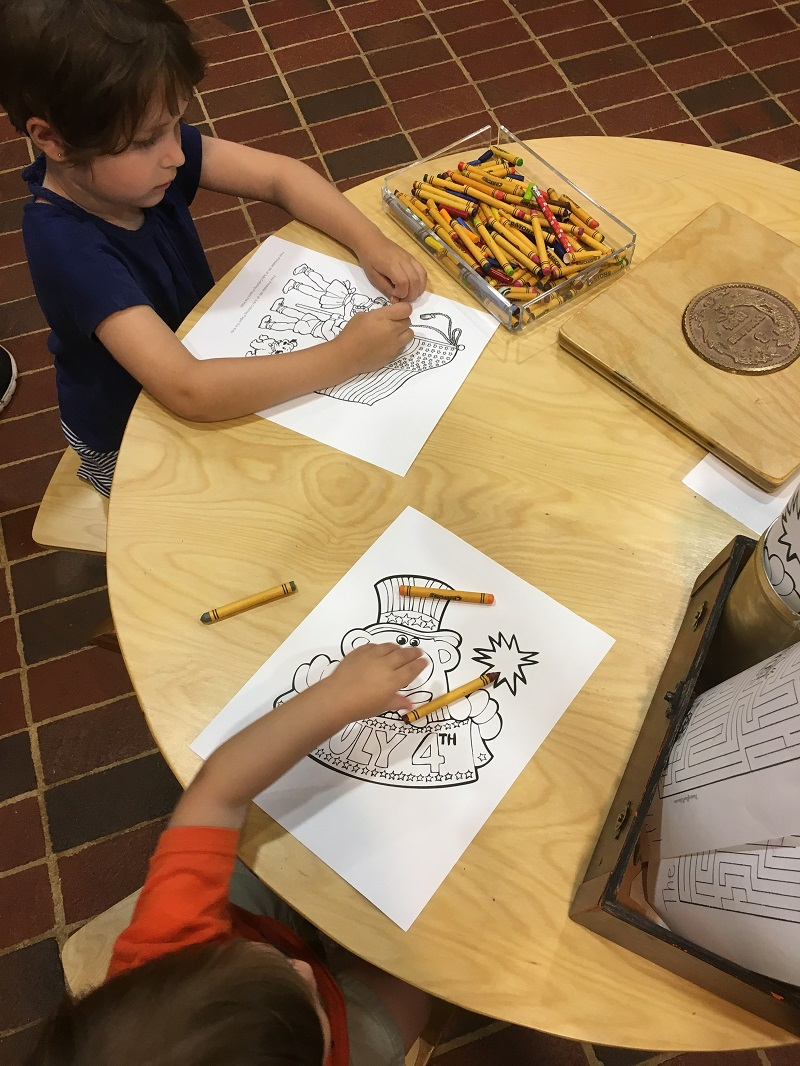 The kids coloring at the gold museum on our gold tour with the Gold Fever Package in Dahlonega, GA www.sahmplus.com