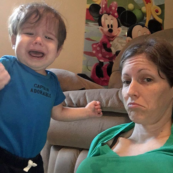 Being a parent sucks - crying son with mom fake pouting.