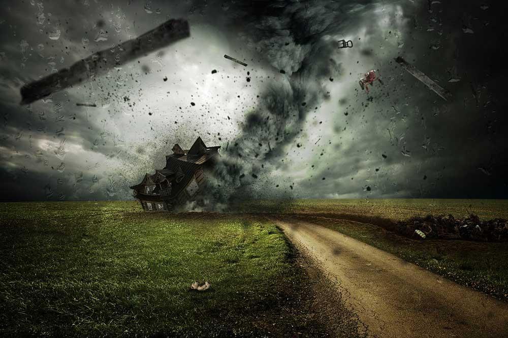 Cyclone destroying home