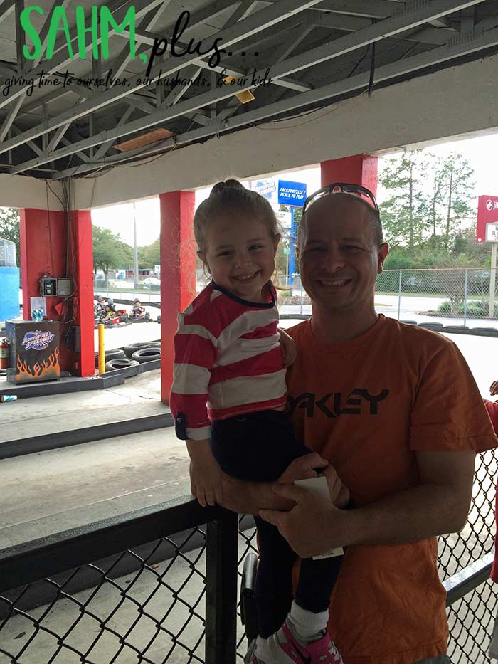 daddy and daughter smiling at Adventure Landing
