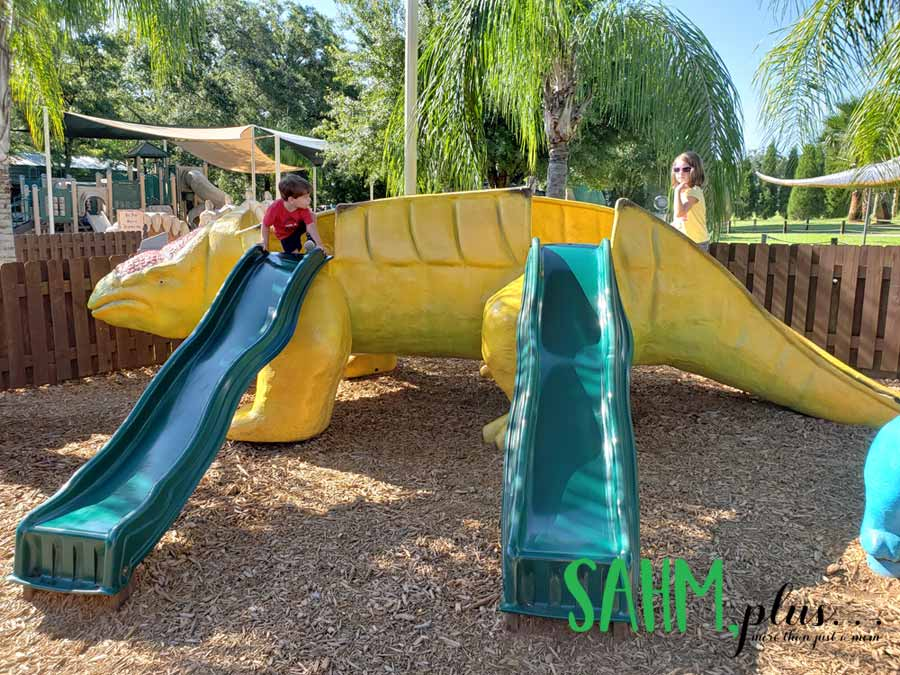 Dinosaur slide on the toddler playground behind the big kid playground at Dinosaur World Plant City, just outside of Tampa | sahmplus.com
