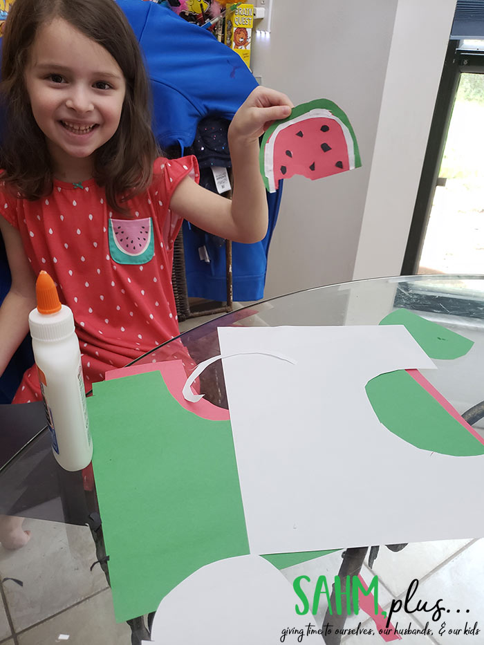 Making watermelon slice out of construction paper. Indoor crafts and art for 3 year olds