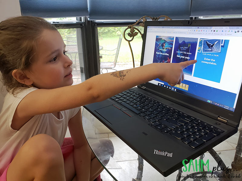 child pointing to fun sweepstakes on Explorer Academy website | sahmplus.com