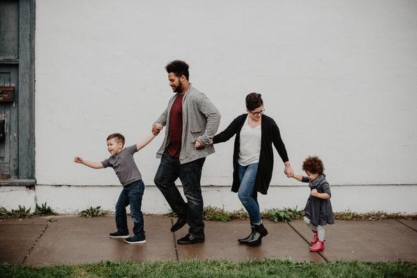 family walking on sidewalk
