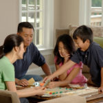 family playing board games safer at home
