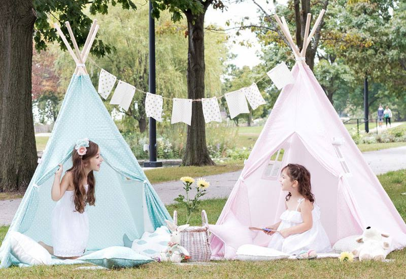 Girls playing in pink and blue Teepee Joy tents