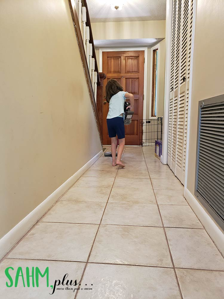 6 year old chores - daughter vacuum hallway, learning responsibility and earning money | sahmplus.com