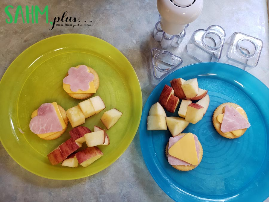 ham and cheese cut into shapes on crackers