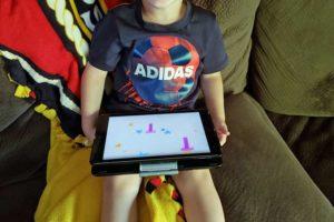 Overjoyed playing Hooked on Phonics on the iPad