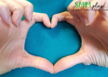 hands making the shape of a heart to celebrate American Heart Month