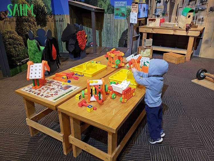play indoors at a museum on a rainy summer day