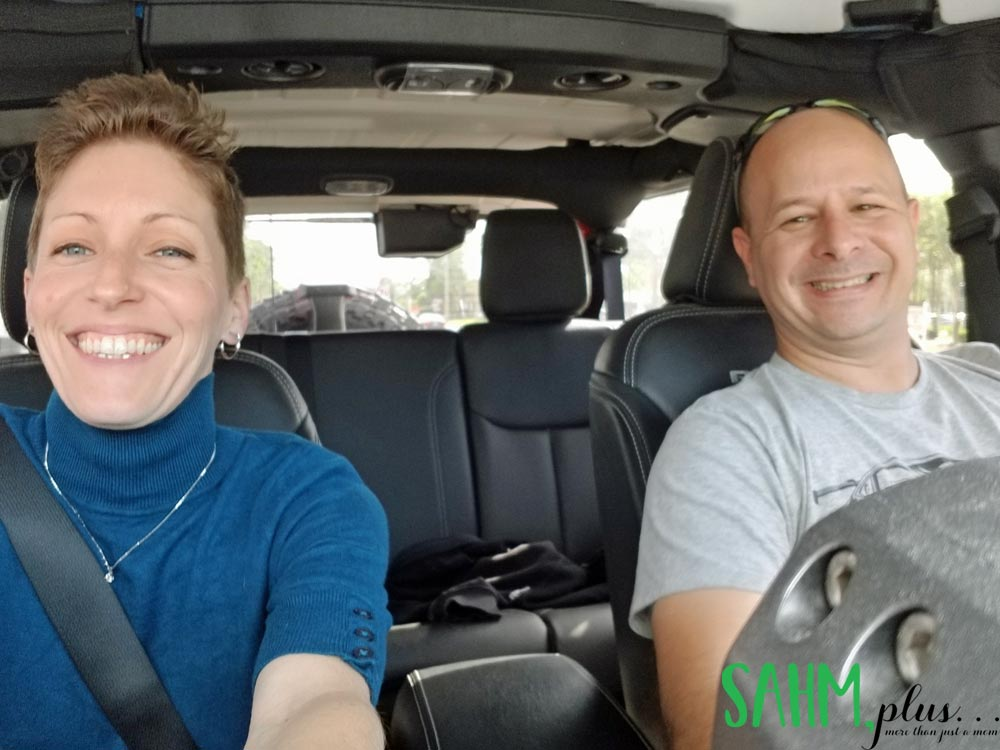 Ivy with husband riding in the jeep | sahmplus.com