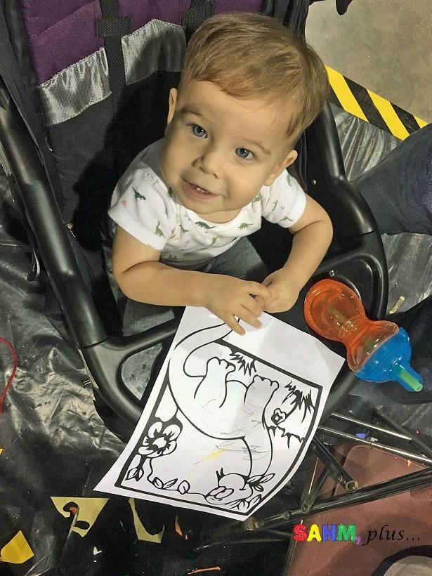 Toddler enjoying coloring at Jurassic Quest Jacksonville FL