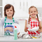 happy kids doing dishes
