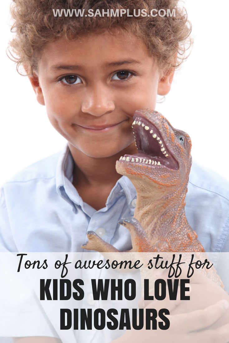 Child hugs dinosaur - pin for Child loves dinosaurs - tons of awesome stuff for kids who love dinosaurs | www.sahmplus.com