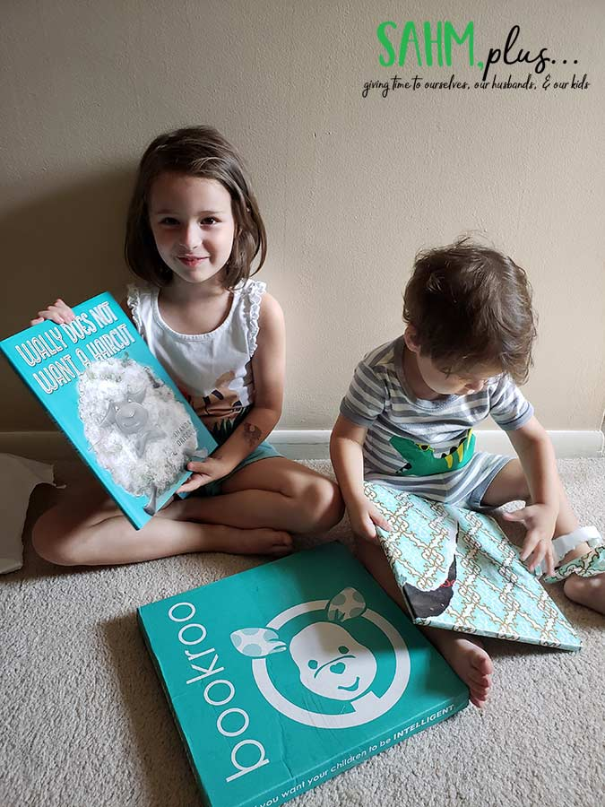 Kids opening Bookroo - monthly book subscription box | sahmplus.com