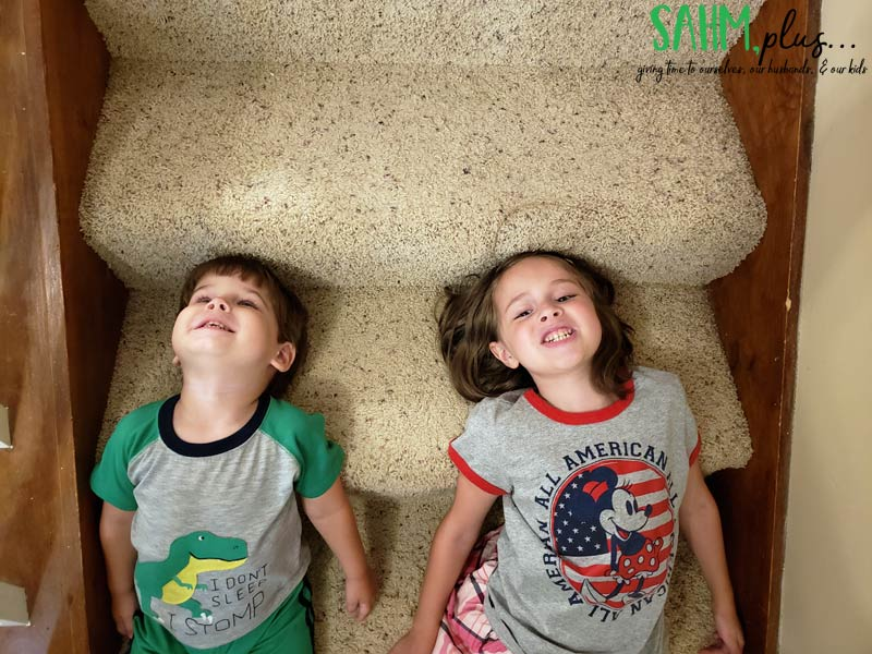 Our kids happily playing on stairs | sahmplus.com