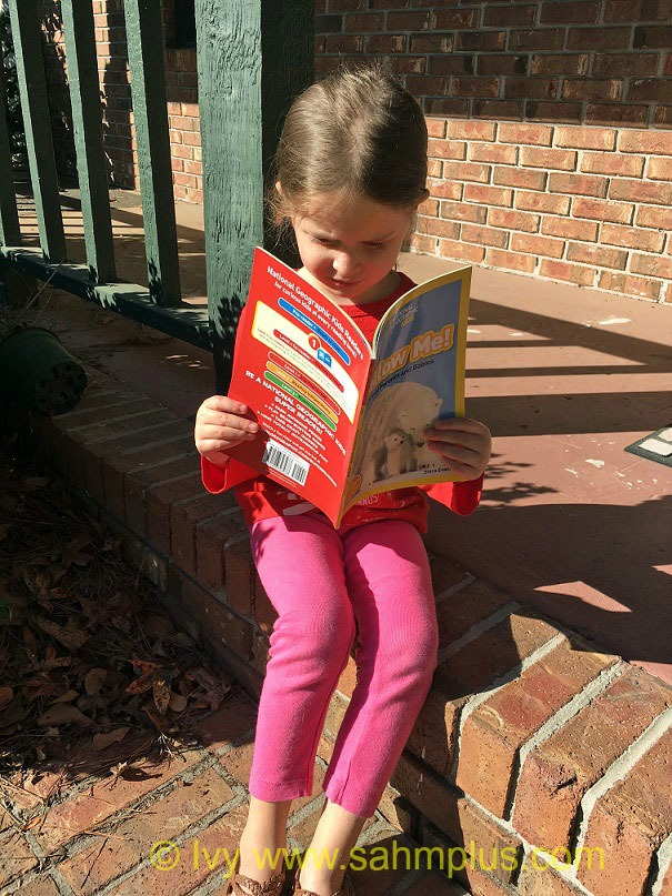 Child reading National Geographic Kids Leveled Readers #ad #momsmeet