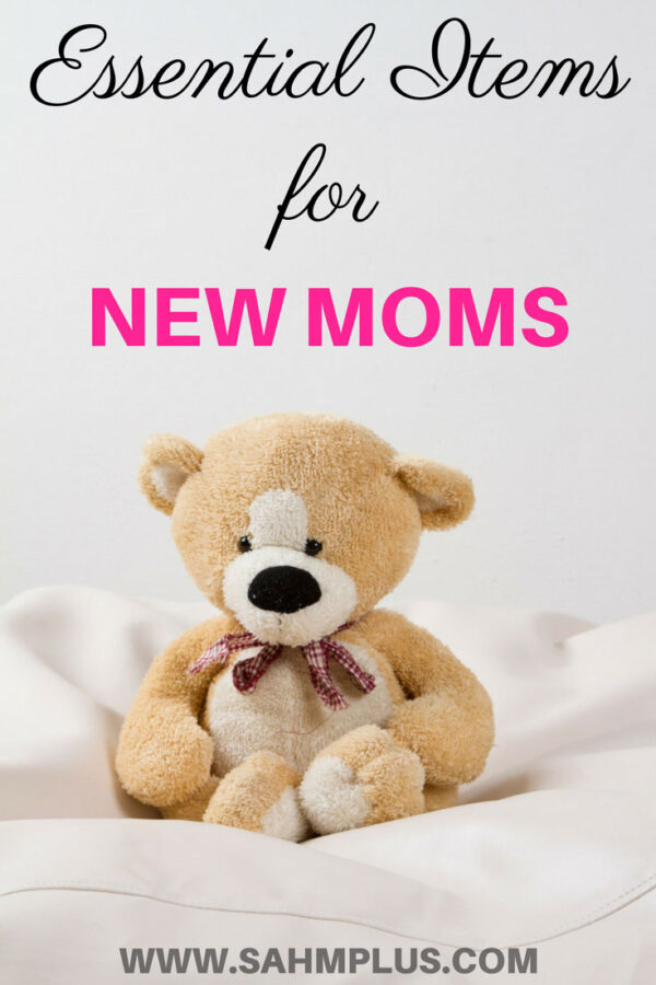 Teddy bear on sheets. Top baby items for new moms pin image