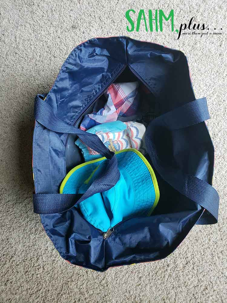 Packed beach bag for little kids at discovery cove | sahmplus.com