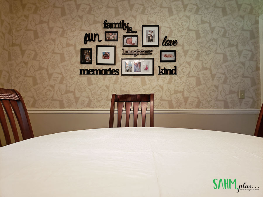 Family photo and word wall in formal dining room | sahmplus.com